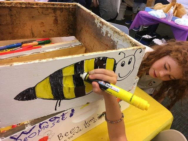Photo of student drawing a bee